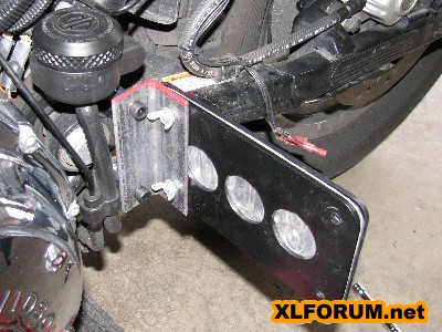 Rubbermount evo license plate bolted to passenger peg for Sportster solid motor mounts